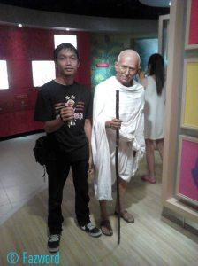 With Mahatma Gandhi's Statue